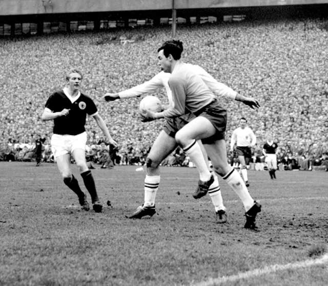 Gordon Banks, right, makes a save against Scotland