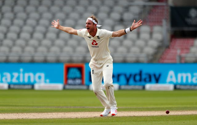 England's Stuart Broad celebrates successfully appealing the lbw of Masood