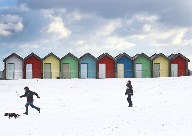 People walk their dogs on Blyth Beach in Northumberland on February 27 last year