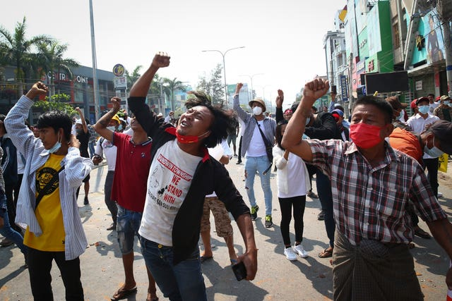 Protesters shout slogans during a protest against the military coup in Mandalay, Myanmar