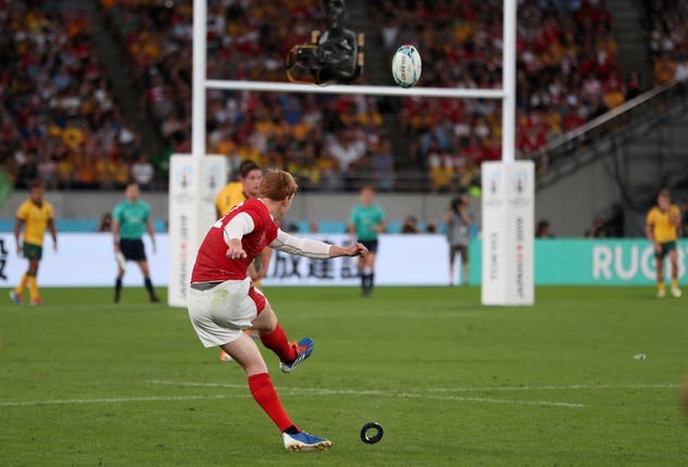 Rhys Patchell kicks at goal against Australia