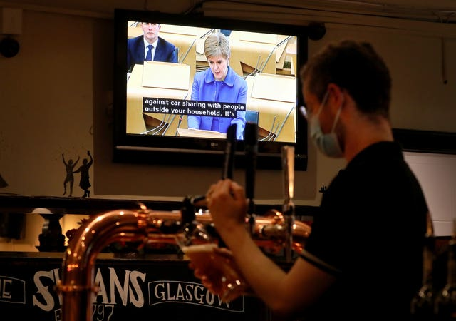 Nicola Sturgeon on TV in a pub