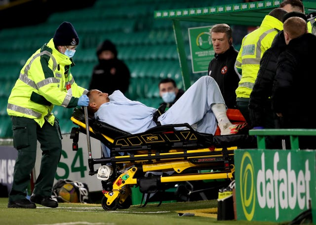 Celtic's Christopher Jullien was stretchered off after colliding with a post