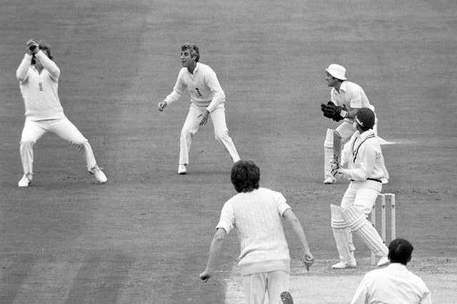 Ian Botham takes a catch off the bowling of Bob Willis
