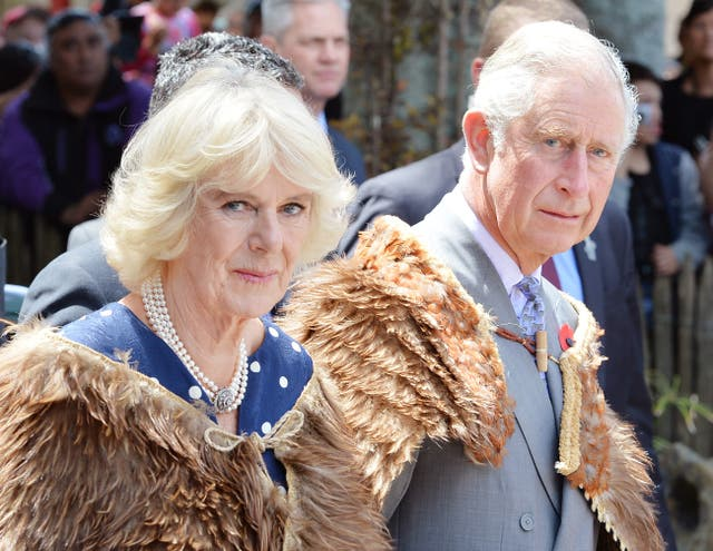 Camilla and Charles wearing ceremonial cloaks made of kiwi feathers during a previous visit to New Zealand