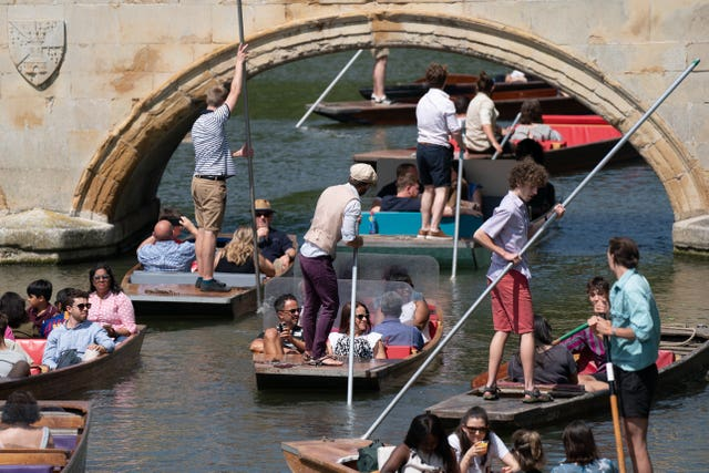 People enjoy punt tours along the River Cam in Cambridge