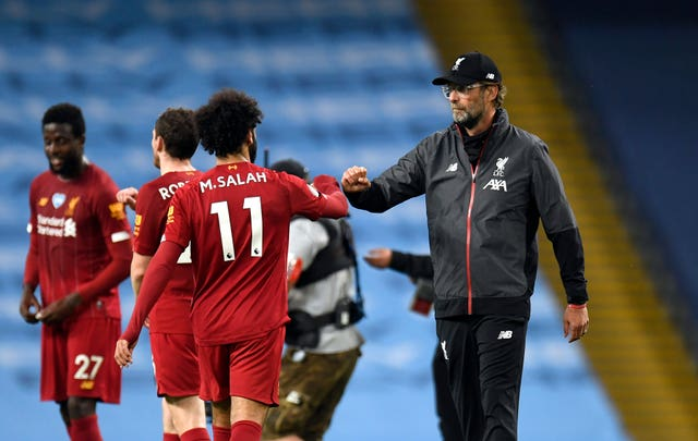 Jurgen Klopp (right) says Liverpool will come again