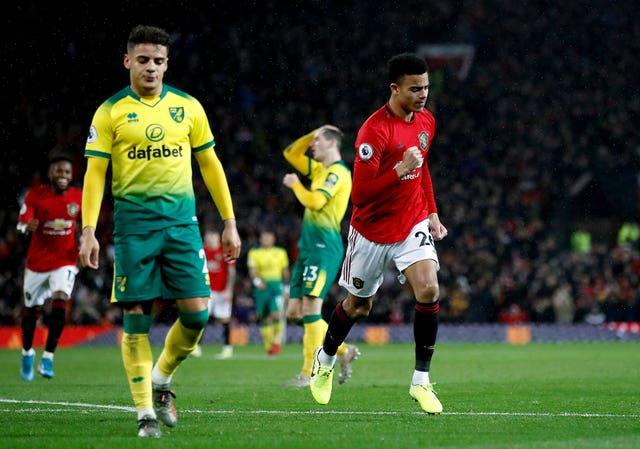Manchester United's Mason Greenwood celebrates scoring from the bench