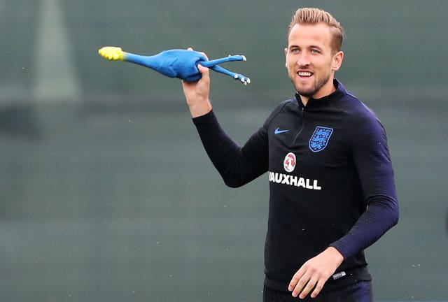 Harry Kane plays with a rubber chicken during the training session at the Spartak Zelenogorsk Stadium