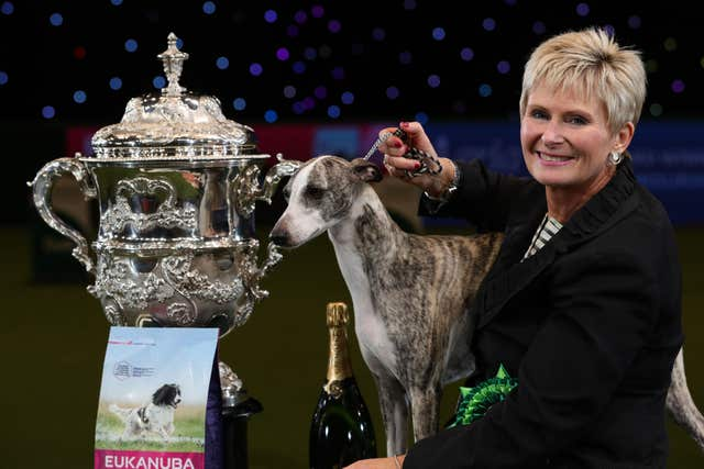 Tease, the Whippet, with owner Yvette Short after she was named Supreme Champion during the final day of Crufts 2018 at the NEC in Birmingham