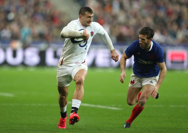 Jonny May scored two second-half tries to spare England's blushes after a poor display in their opening Guinness Six Nations match