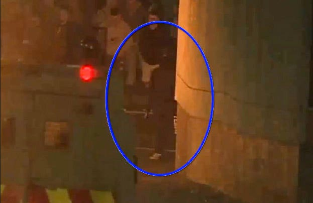 CCTV image of the man (circled) suspected of firing the shots that killed Lyra McKee