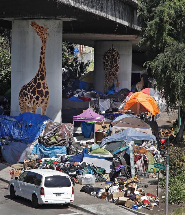 A homeless encampment under a flyover in Oakland, California