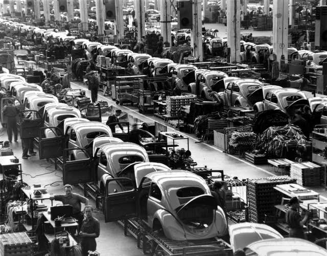 VW Beetles are assembled in lines at the Volkswagen auto works plant in 1954