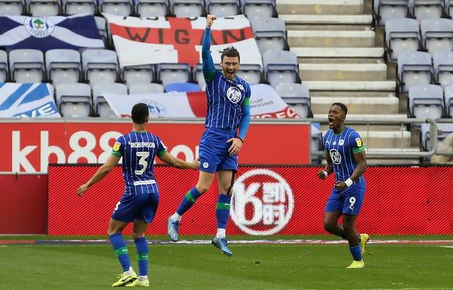 Wigan led against Fulham through Kieffer Moore