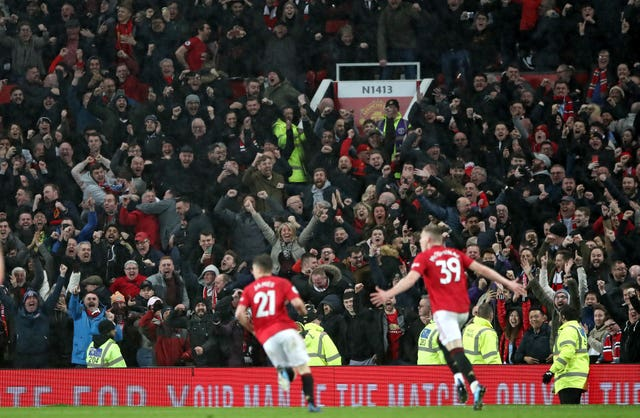 Scott McTominay celebrates scoring Manchester United's second against Manchester City in March