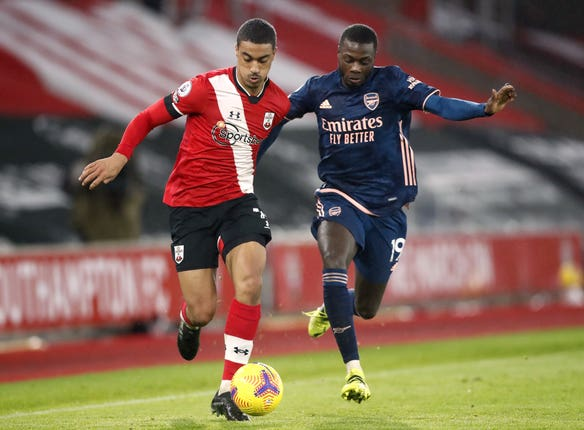 Yan Valery (left) came into the Southampton side against Arsenal.