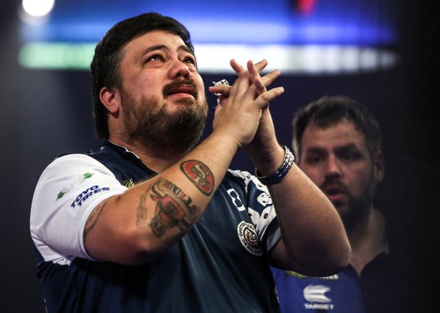 Danny Baggish (left) cries after beating Adrian Lewis (right) at the PDC World  Championship