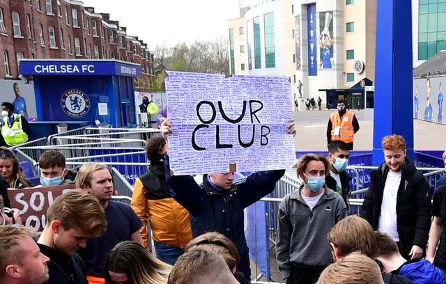 Fans protest against Chelsea's involvement in the new European Super League outside Stamford Bridge