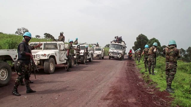 UN peacekeepers guard the area where a convoy was attacked