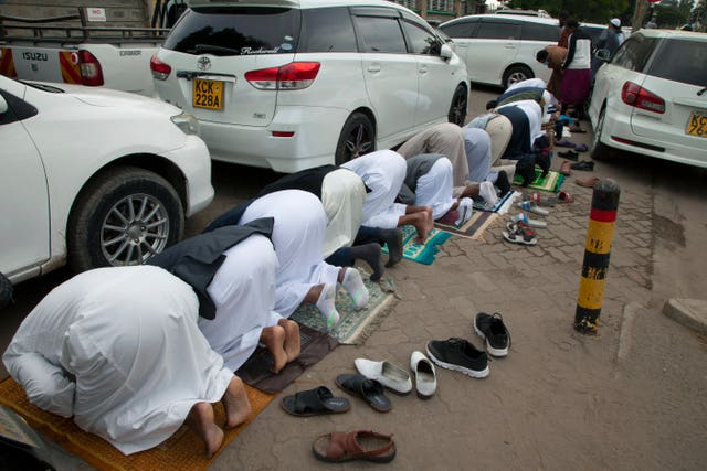Muslim men offer prayers in Nairobi, Kenya