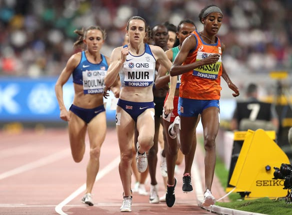 Laura Muir, centre, runs on the shoulder of race winner Sifan Hassan, right