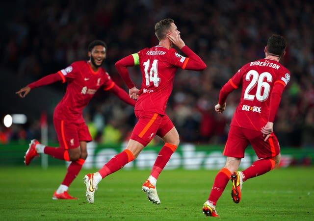 Jordan Henderson (centre) celebrates scoring Liverpool's winner