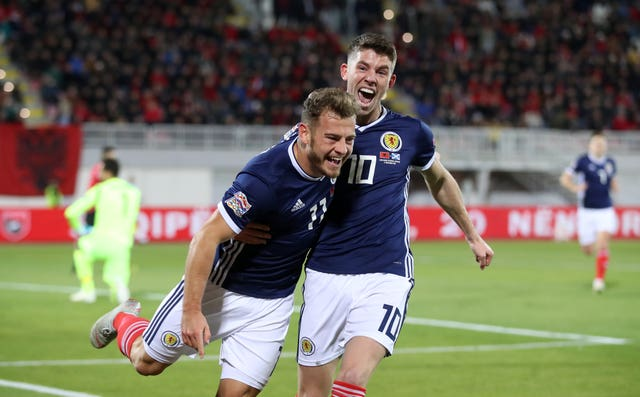 Ryan Fraser, left, celebrates his first goal for Scotland