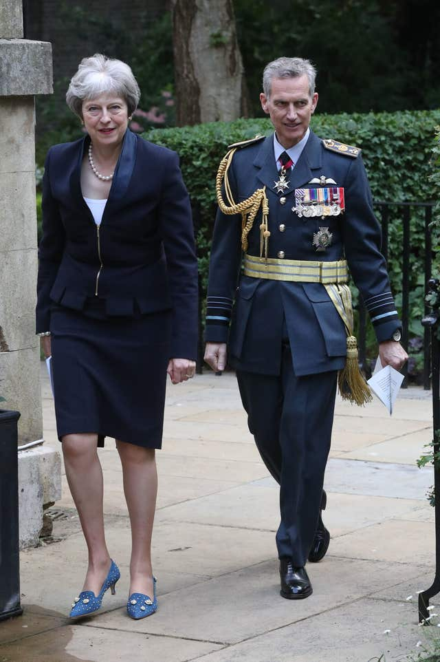 Prime Minister Theresa May walks with Air Chief Marshal Sir Stephen Hillier (Jonathan Brady/PA)