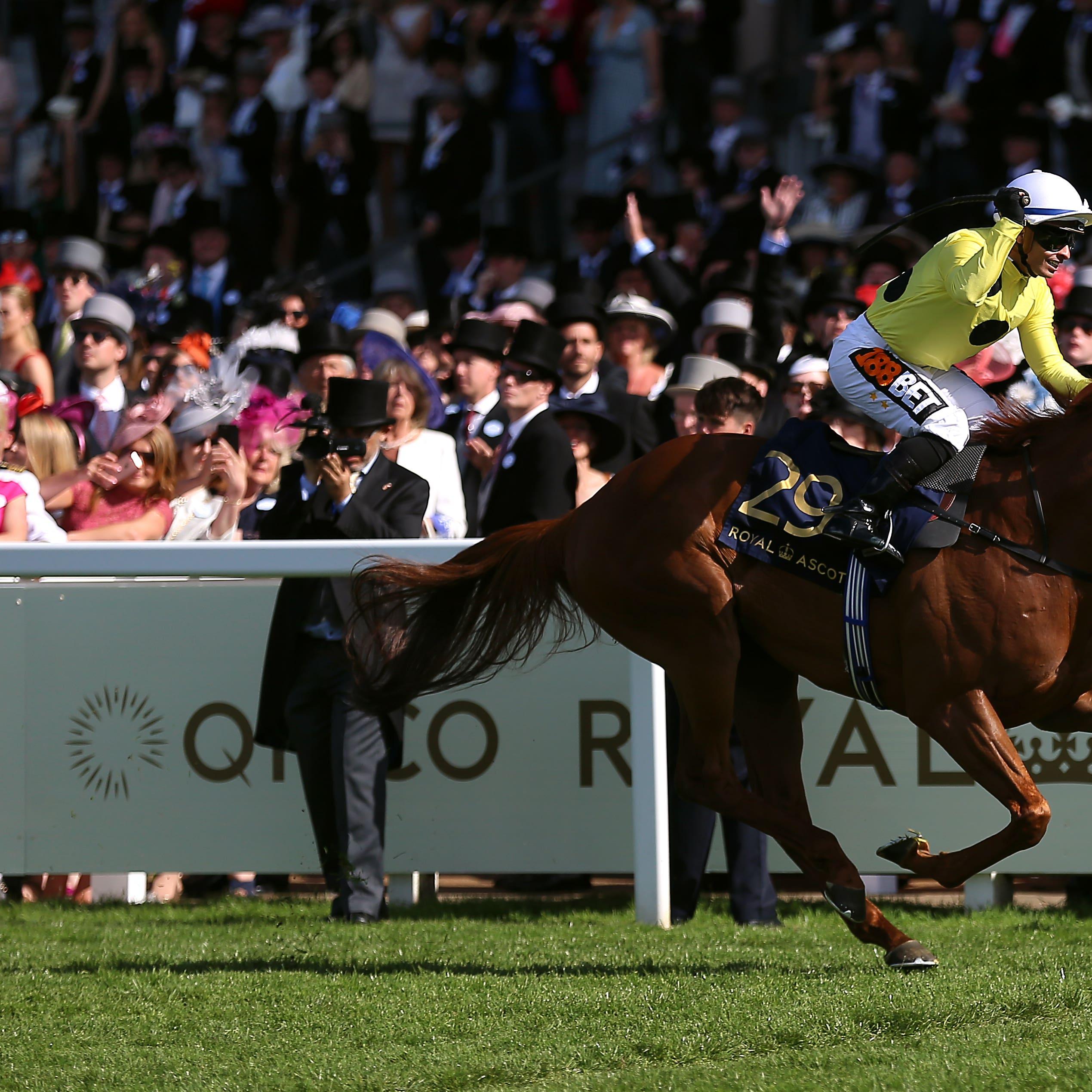 Silvestre de Sousa salutes the crowd as Ostilio wins the Britannia Stakes