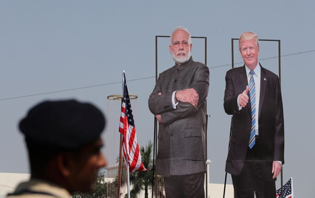 India has rolled out the red carpet for Donald Trump, with his image appearing across Ahmedabad