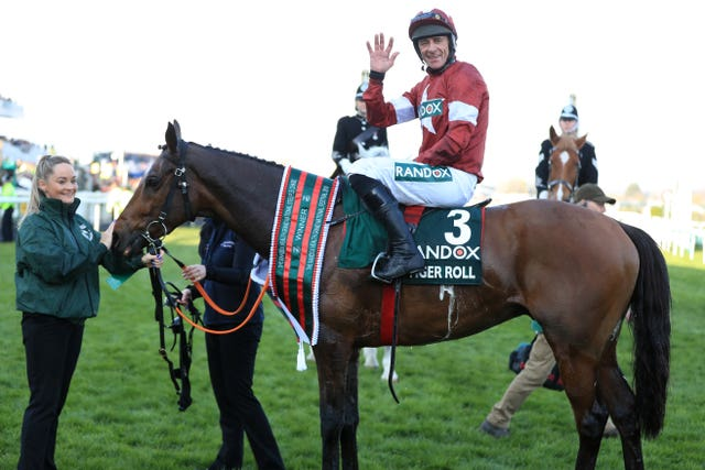 Davy Russell celebrates winning the National with Tiger Roll