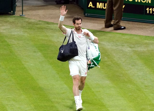Andy Murray waves to the crowd after his third round match defeat against Denis Shapovalov on day five of Wimbledon (John Walton/PA)