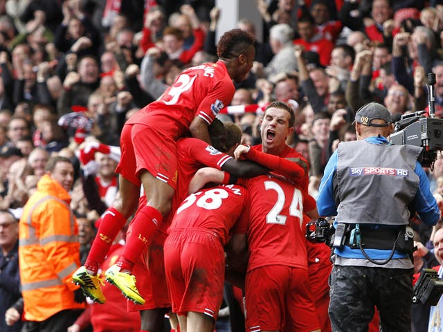 Liverpool players celebrate after Philippe Coutinho scores