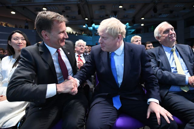 Jeremy Hunt congratulates Boris Johnson at the Queen Elizabeth II Centre in London