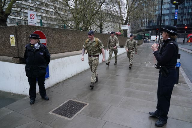Military personnel and police officers outside St Thomas' Hospital
