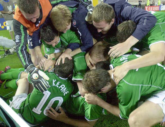 Republic of Ireland striker Robbie Keane (left) is mobbed by team-mates after his last-gasp equaliser against Germany