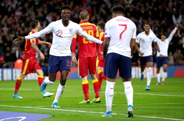 Twenty-two-year-old Tammy Abraham celebrates his first England goal with Jadon Sancho, 19