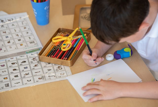 Child working in class