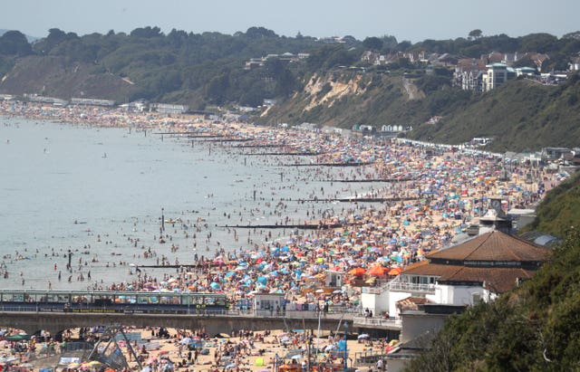 People enjoying the hot weather at Bournemouth beach in Dorset