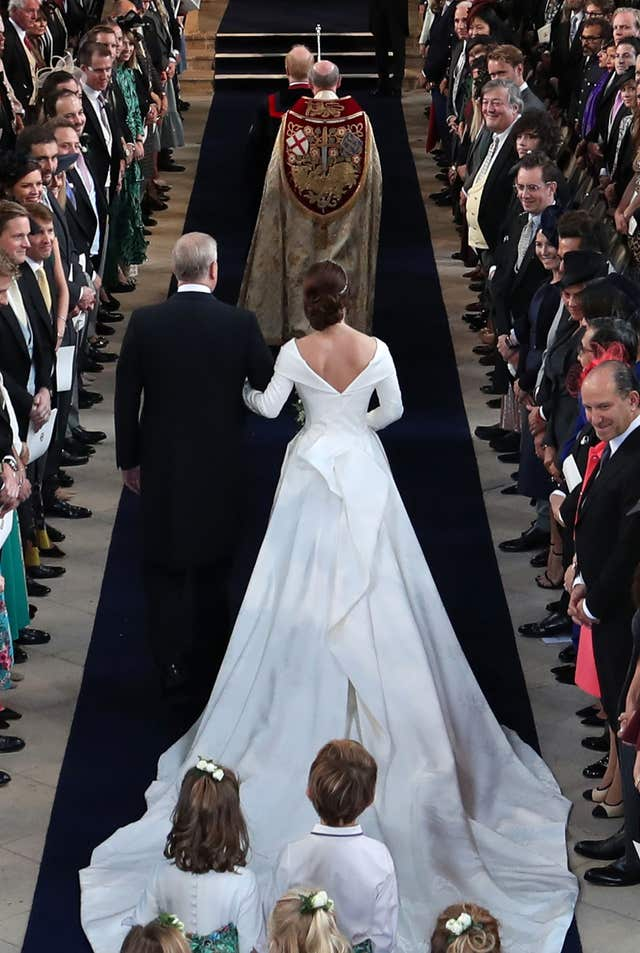 The Duke of York walks his daughter Princess Eugenie down the aisle for her wedding to Jack Brooksbank at St George's Chapel in Windsor Castle (Danny Lawson/PA)