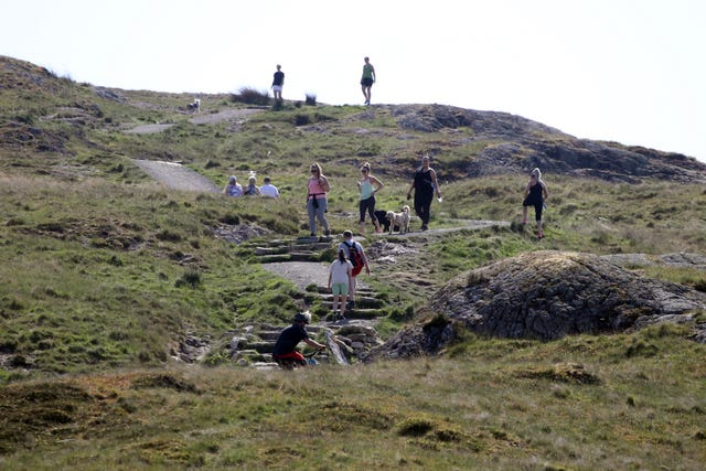 Walkers practice social distancing on Dumyat (Andrew Milligan/PA)
