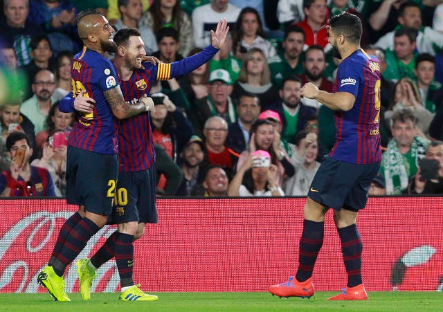 Lionel Messi, left, netted his 51st career hat-trick in the win over Real Betis