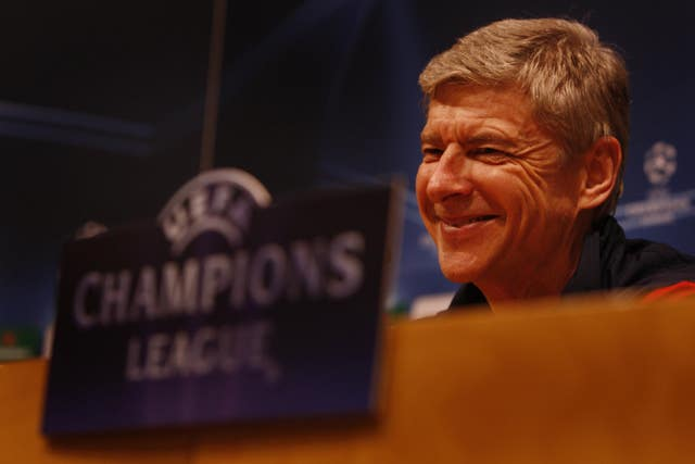 Arsene Wenger smiles during a Champions League press conference with Arsenal