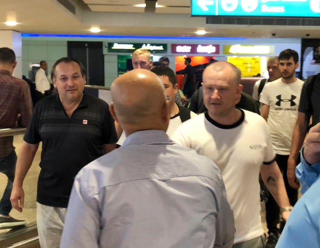 Mariners from the MT Front Altair arrive at Dubai International Airport