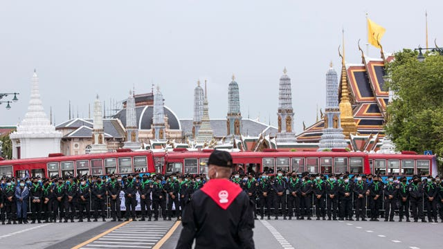 Police officers guard the area surrounding the Grand Palace