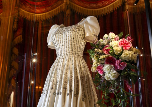 Princess Beatrice's wedding dress which will go on public display at Windsor Castle from Thursday. Steve Parsons/PA Wire
