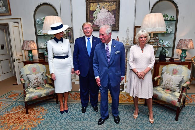 US President Donald Trump and his wife Melania at Clarence House with the Prince of Wales and Duchess of Cornwall