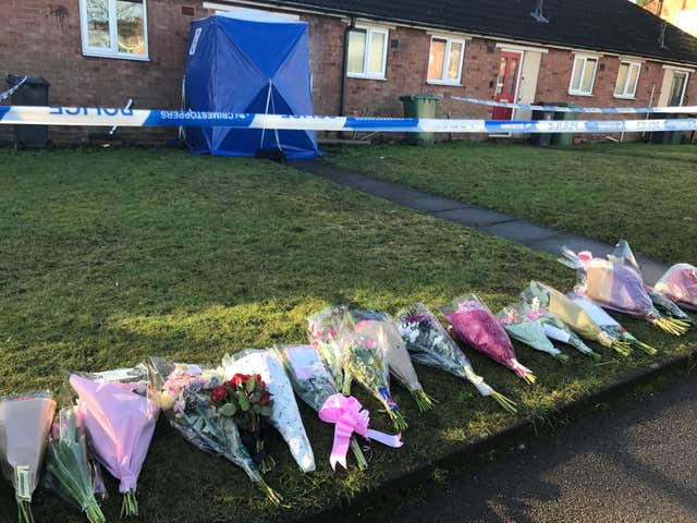 Floral tributes in remembrance of Mylee Billingham outside the property in Brownhills, near Walsall, where the eight-year-old was found with fatal knife wounds (Phil Barnett/PA)