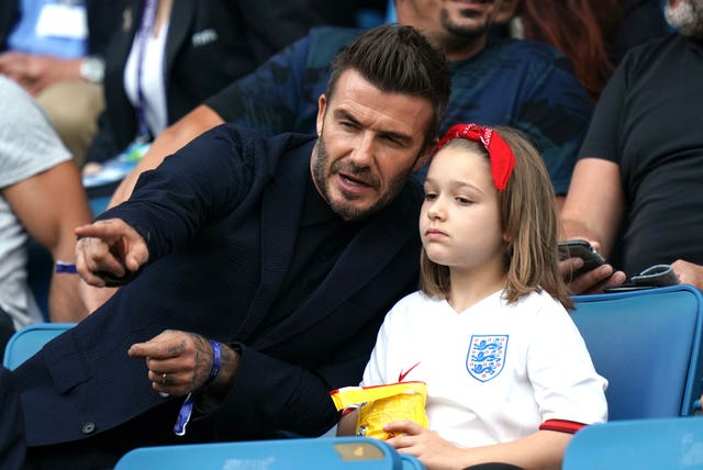 David and Harper Beckham watch England's win over Norway